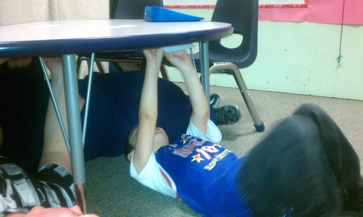 kid under table