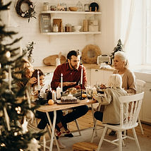 family-sitting-near-dining-table-and-eat