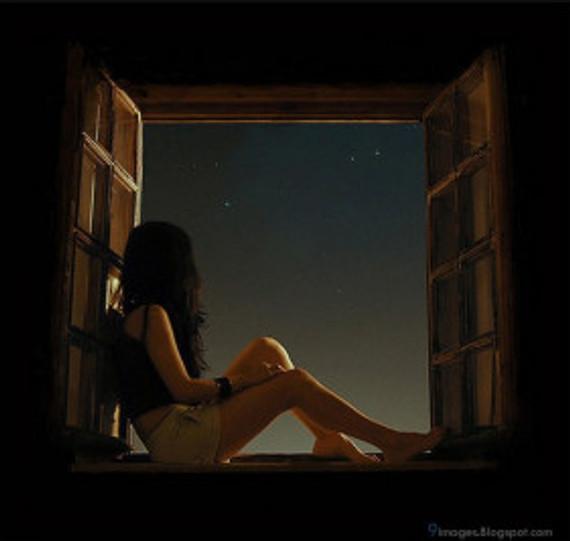 alone-girl-sitting-on-window-waiting-someone