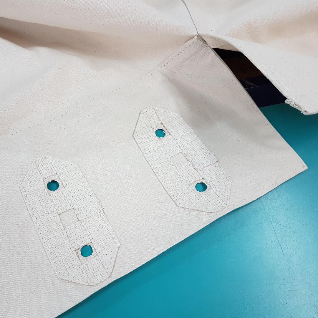 Tipi reinforeced button holes