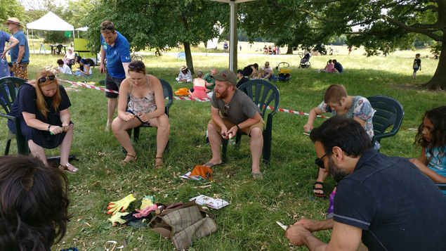 adult and child whittling workshop at hampsted heath community event