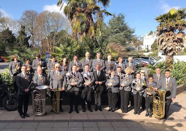 St Pinnock Brass Band ready to play a set with brass instruments