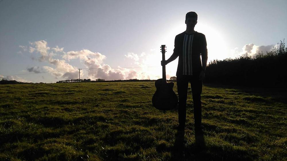 Luke Bunkum, acoustic guitar, solo artist