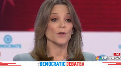 Mysterious Woman Commandeered Spare Podium During Democratic Debate