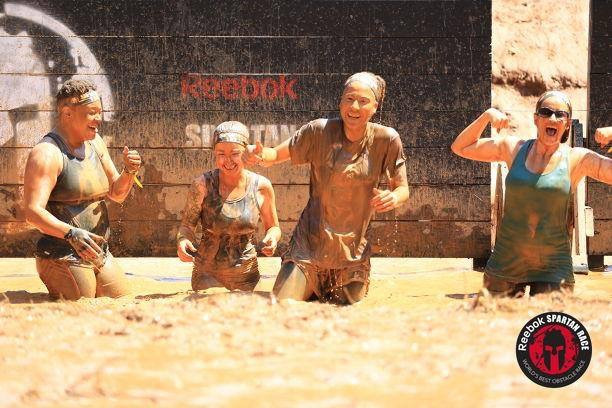 Pictured are co-owner Kelly Jackson along with Misfit athletes Trina Evans, Gina Taylor, and Nicole Wilkerson. These 4 with some other Misfit athletes completed a Spartan Race back in 2017. For some of the athletes this was their very first Spartan Race. As you can see things got rather muddy.