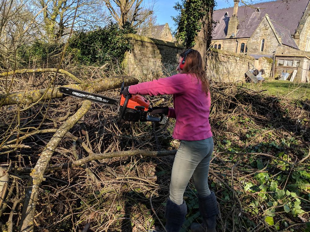 Caroline with chainsaw