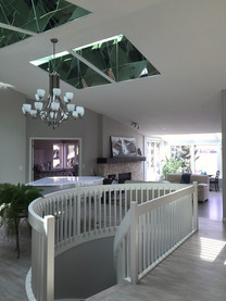 Painted Livingroom Walls and Sprayed Ceiling and Railings of this Chestermere home