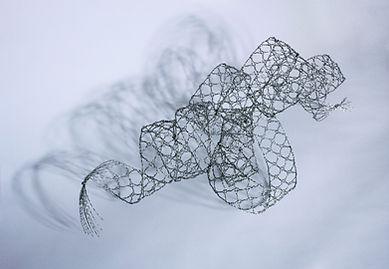 Lace Twelve: Oskar Schlemmer's Dancer  Pedestal-supported Sculpture  Stainless Steel – Bobbin Lace  © 1991-2020 Barbara Berk Designs, LLC  All Rights Reserved
