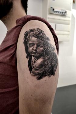 tatouage cherub black corner tattoo