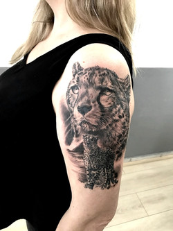 tattoo guepard black corner tattoo