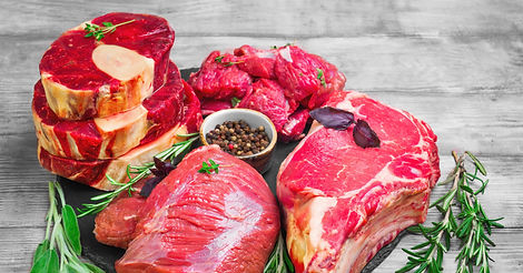 Different%20types%20of%20meat%20beef%20on%20round%20board.%20Herbs%20for%20an%20assortment%20of%20be
