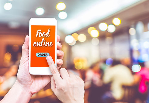 Hand holding mobile with Order food onli