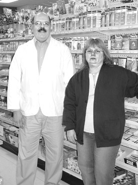 Pharmacist Richard Gubbiotti and pharmacy technician Cathy Dahlmeyer encourage parents to monitor their children's use of over-the-counter medication.   - Bee Photo, Lytwyn