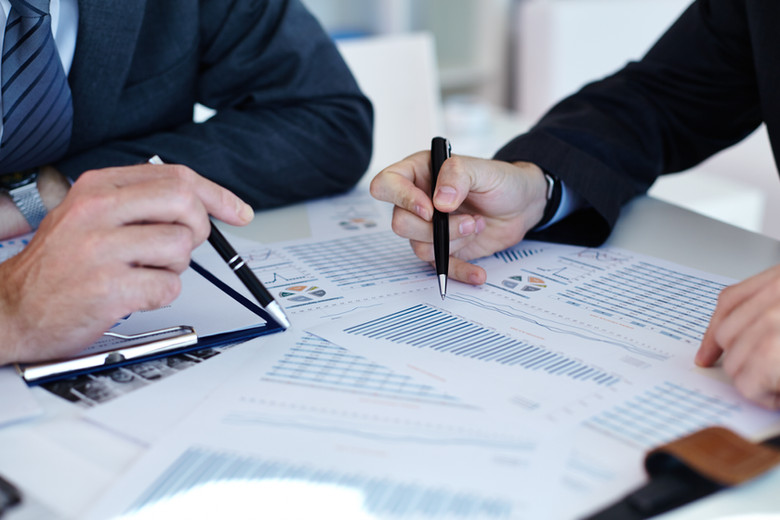 stellar it solutions miami florida financial it services two people working on financial documents