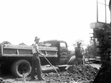 Rust Co. truck & workers