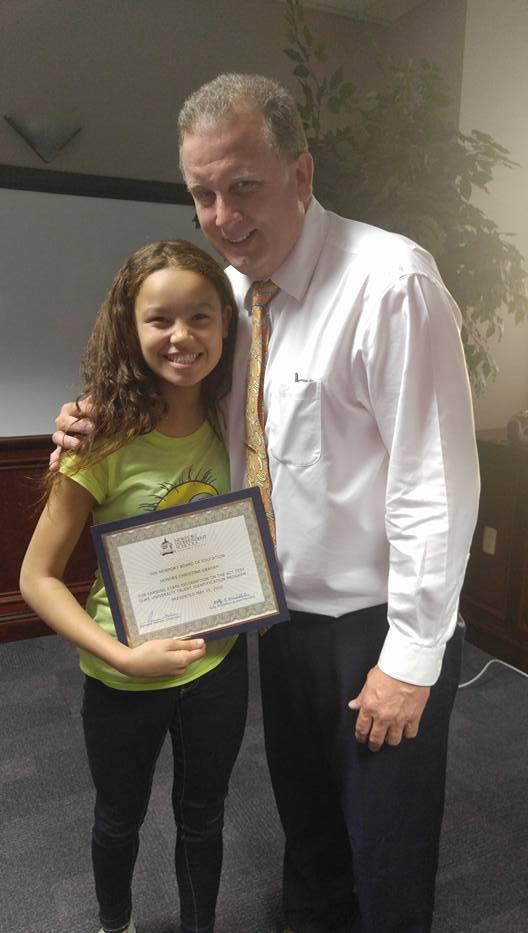 Kelly with Kid Award.jpg