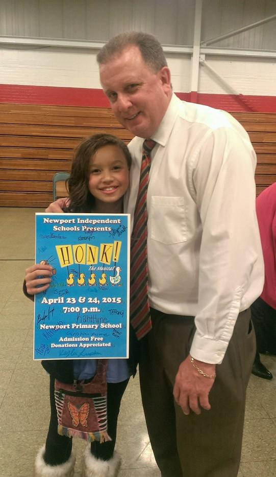 Kelly with Kid Holding Poster.jpg