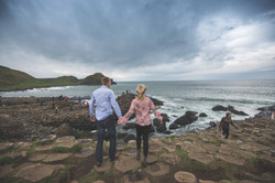 Engaged couple at giants causeway