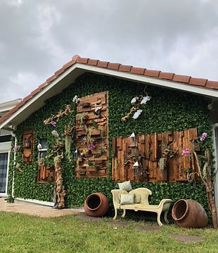 Wooden outdoor wall with greens and flowers