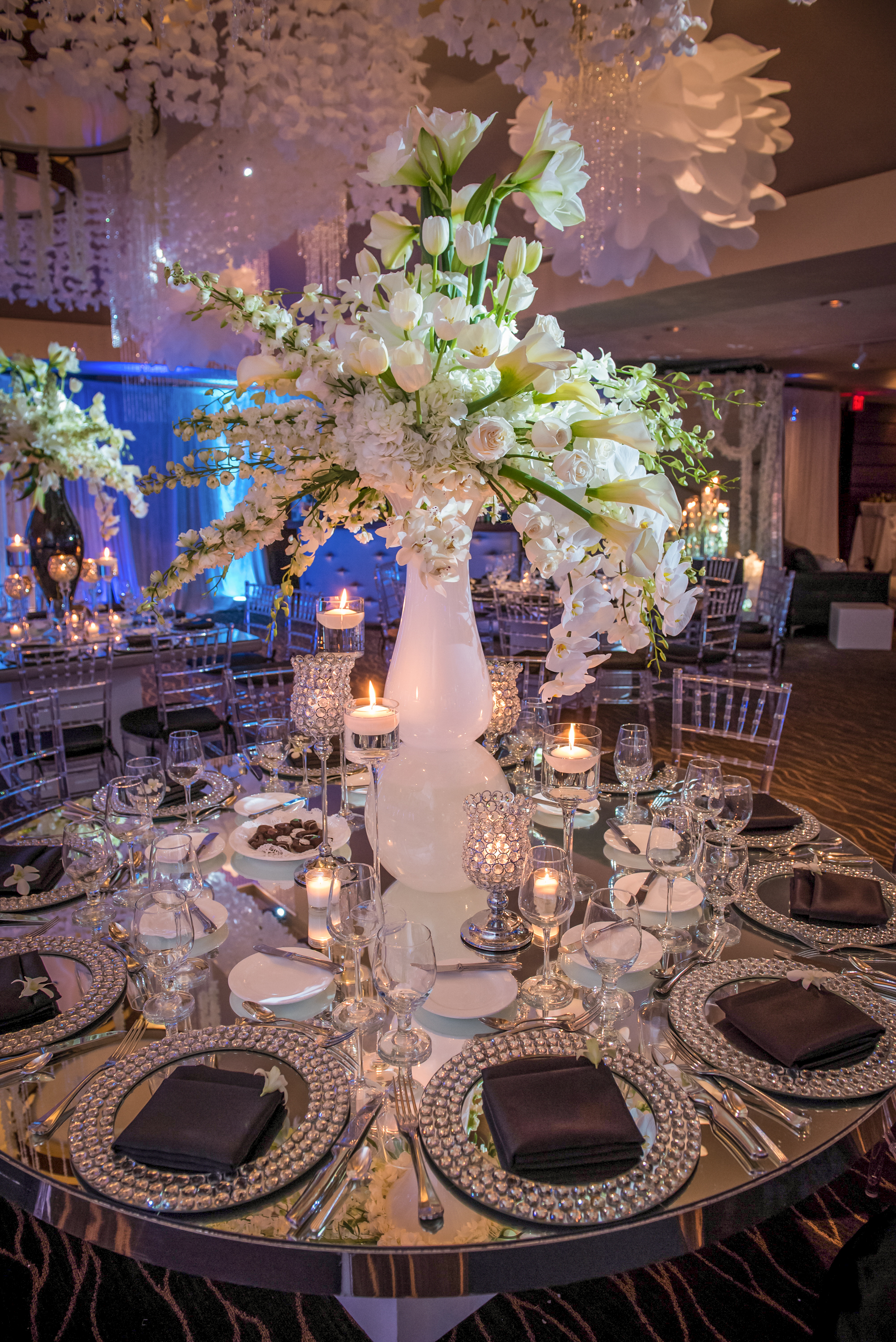 Beautiful reception with tall white centerpiece