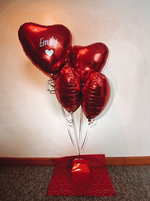 Red heart balloon with chocolate box