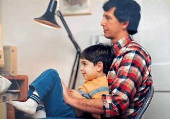 Father and Son. Probably playing Space Invaders on a 1985 Macintosh Plus