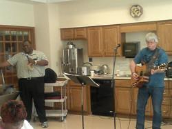 Mark playing guitar for John