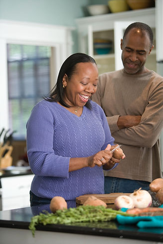 African American couple preparing a meal