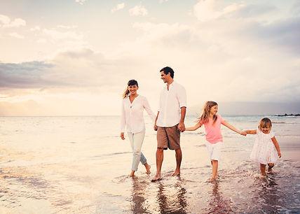 Happy Young Family Having Fun Walking on
