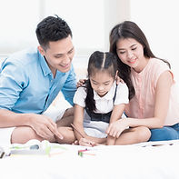 Happy family on white bed in the bedroom