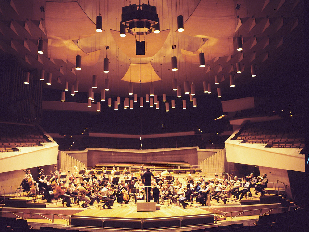 Photo of an orchestra in a symphony hall