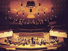 We work with orchestras around the world to create original works.