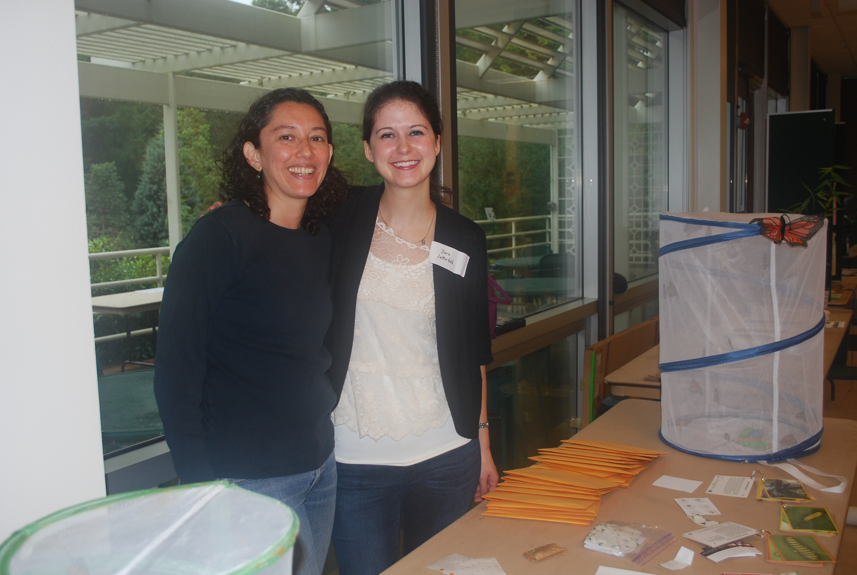 Dara Satterfield and Paola Barriga smiling after wrapping up a busy year at Insectival 2015