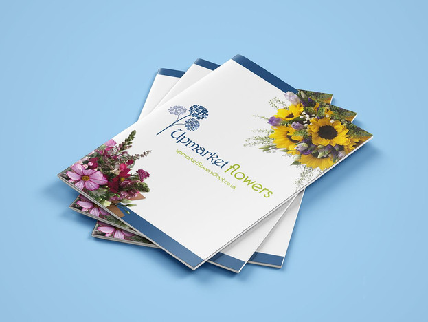 Pile of floriists brochure design at Wild Apple Design