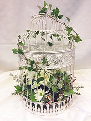 Floral display in an antique bird cage