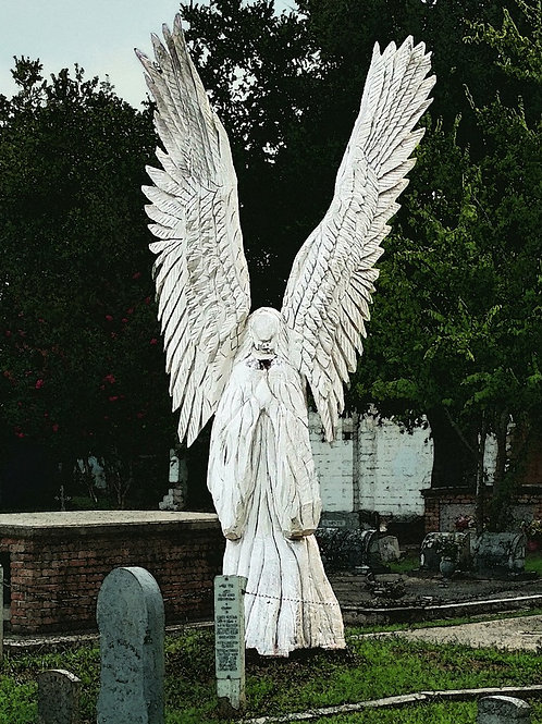 Carved Wooden Angel statue in Bay St Louis Cemetery