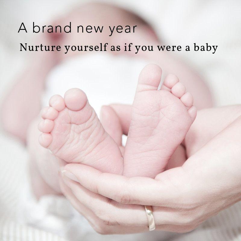 hand holding baby feet