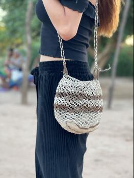 MurphsLife Girl wearing handmade bag from Native Uruguay Tribes