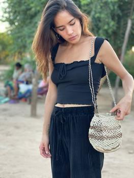 MurphsLife Girl wearing handmade bag from Native Uruguay Tribe