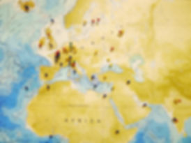 Europe Detail of Bathymetric Chart of the Oceans with color-coded pins marking locations.  Yellow = birthplaces & family heritage sites, Red = education sites, Green = lab graduates, Blue = places members want to work or visit