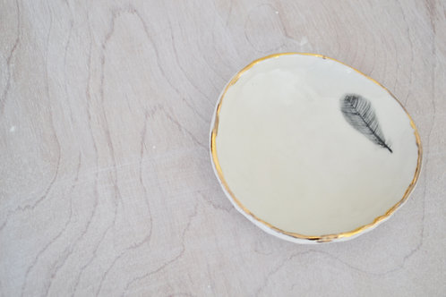 feather ring dish with gold rim