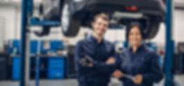 Auto car repair service center. Two happ
