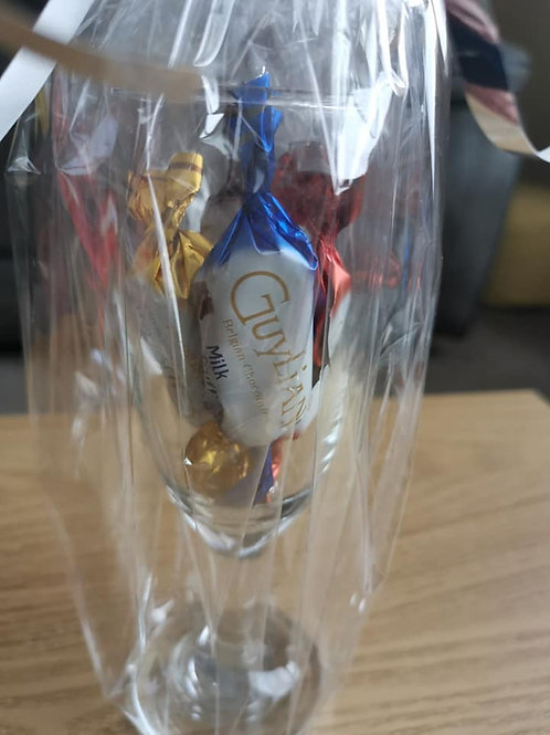 4x different flavour Guylian chocolates in a prosecco glass