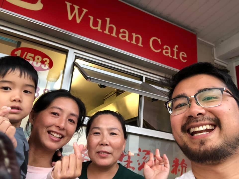 Our family with the owner of Wuhan Cafe