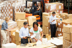 Workers-In-Warehouse-Preparing-Goods-For-Dispatch