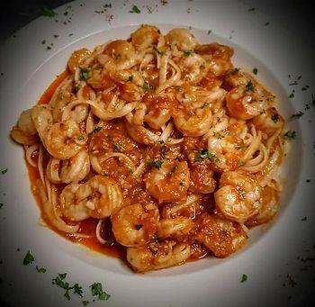 shrimp in garlic sauce over linguini.jpg