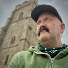 Sitting on top of the world.  A selfie on Glastonbury Tor,   Somerset, England.