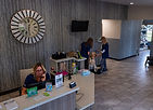 Front Desk. Judy on Phone, Stan getting