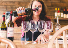 Julie pouring some wine