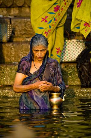 India Pilgrim praying on the step of Gan